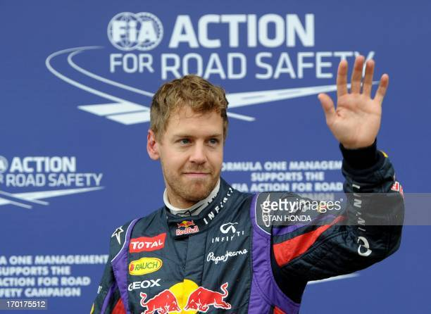 Pole winner Red Bull driver Sebastian Vettel of Germany waves after qualifying at the Canadian Formula One Grand Prix at the Circuit Gilles...