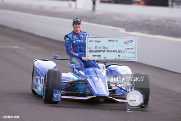 Pole winner Scott Dixon holding his $100000 check during the Front Row Photo Shoot for the 101st Indianapolis on May 22 at the Indianapolis Motor...