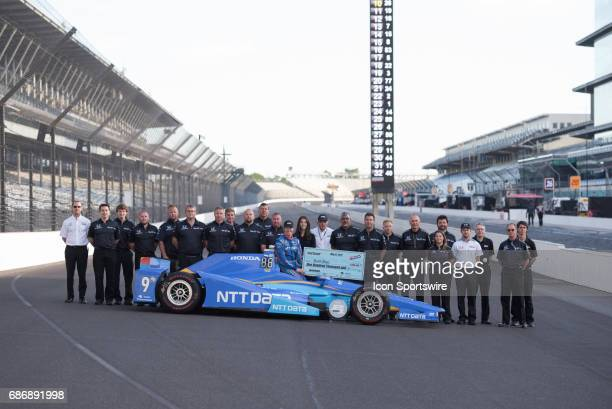 Pole winner Scott Dixon holding his $100000 check with his team during the Front Row Photo Shoot for the 101st Indianapolis on May 22 at the...