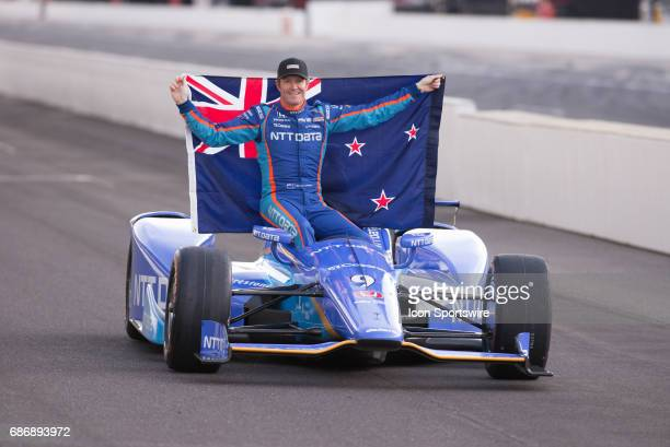 Pole winner Scott Dixon holding the New Zealand flag during the Front Row Photo Shoot for the 101st Indianapolis on May 22 at the Indianapolis Motor...