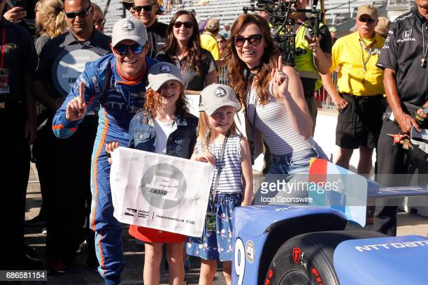 Pole winner Scott Dixon of Chip Ganassi Racing celebrates with daughters Poppy Tilly and his wife Emma after winning the pole for the 2017...
