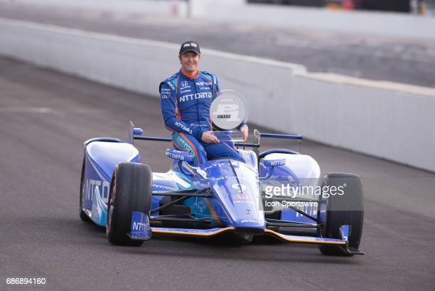 Pole winner Scott Dixon trophy during the Front Row Photo Shoot for the 101st Indianapolis on May 22 at the Indianapolis Motor Speedway in...