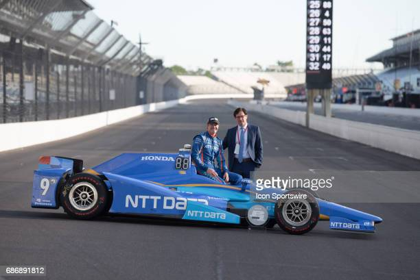 Pole winner Scott Dixon with Indianapolis Motor Speedway President Doug Boles during the Front Row Photo Shoot for the 101st Indianapolis on May 22...