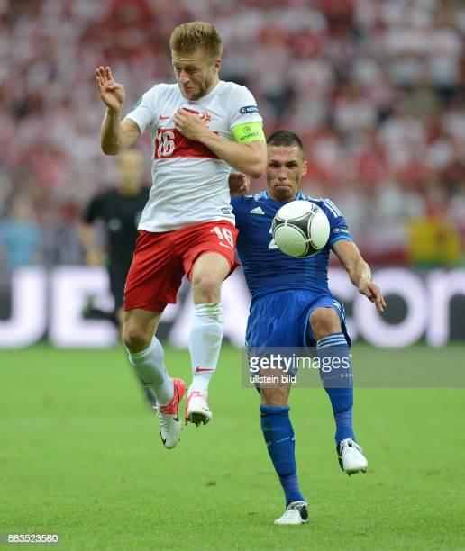 FUSSBALL EUROPAMEISTERSCHAFT Polen Griechenland Jakub KUBA Blaszczykowski gegen Jose Holebas