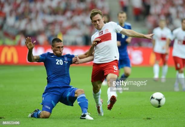 FUSSBALL EUROPAMEISTERSCHAFT Polen Griechenland Jose Holebas gegen Maciej Rybus