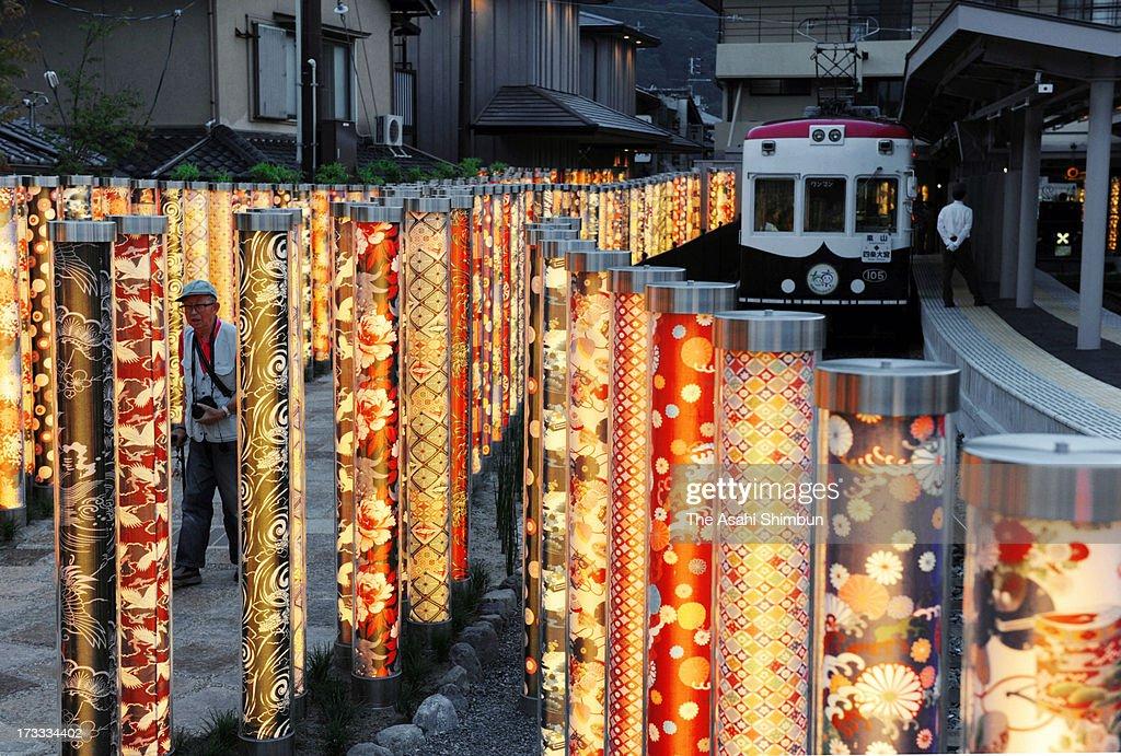 600 poles of Yuzen style dyed fabrics are illuminated at Arashiyama Station on July 11 2013 in Kyoto Japan The illumination named 'Kimono Forest'...