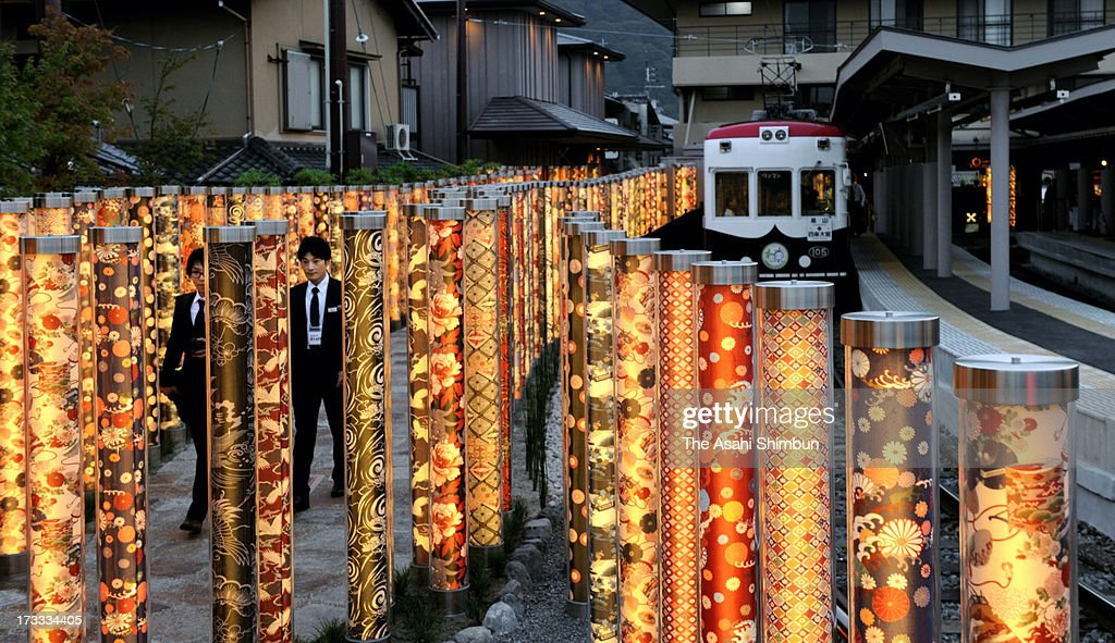 600 poles of Yuzen style dyed fabrics are illuminated at Arashiyama Station on July 11, 2013 in Kyoto, Japan. The illumination, named 'Kimono Forest' after Yuzen dying, one of the specialities of the area, is created by designer Yasumichi Morita.