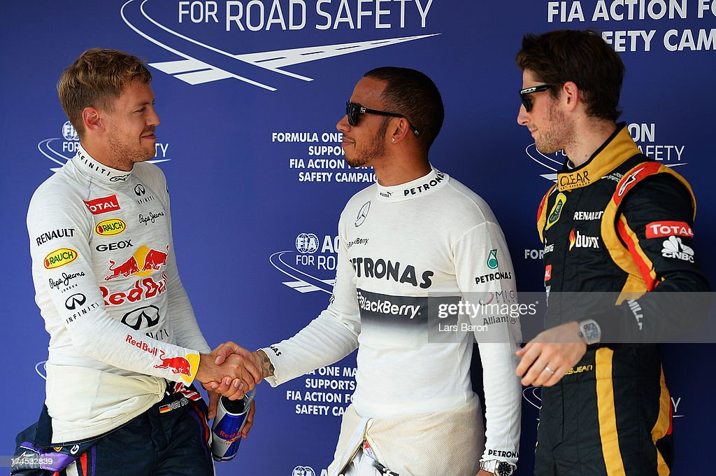 Polesitter <a gi-track='captionPersonalityLinkClicked' href=/galleries/search?phrase=Lewis+Hamilton&family=editorial&specificpeople=586983 ng-click='$event.stopPropagation()'>Lewis Hamilton</a> (C) of Great Britain and Mercedes GP celebrates with second placed <a gi-track='captionPersonalityLinkClicked' href=/galleries/search?phrase=Sebastian+Vettel&family=editorial&specificpeople=2233605 ng-click='$event.stopPropagation()'>Sebastian Vettel</a> (L) of Germany and Infiniti Red Bull Racing and third placed <a gi-track='captionPersonalityLinkClicked' href=/galleries/search?phrase=Romain+Grosjean&family=editorial&specificpeople=4858519 ng-click='$event.stopPropagation()'>Romain Grosjean</a> (R)of France and Lotus following qualifying for the Hungarian Formula One Grand Prix at Hungaroring on July 27, 2013 in Budapest, Hungary.