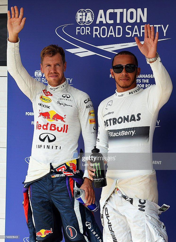Polesitter <a gi-track='captionPersonalityLinkClicked' href=/galleries/search?phrase=Lewis+Hamilton&family=editorial&specificpeople=586983 ng-click='$event.stopPropagation()'>Lewis Hamilton</a> (R) of Great Britain and Mercedes GP celebrates with second placed <a gi-track='captionPersonalityLinkClicked' href=/galleries/search?phrase=Sebastian+Vettel&family=editorial&specificpeople=2233605 ng-click='$event.stopPropagation()'>Sebastian Vettel</a> (L) of Germany and Infiniti Red Bull Racing following qualifying for the Hungarian Formula One Grand Prix at Hungaroring on July 27, 2013 in Budapest, Hungary.