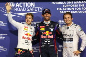 Polesitter Mark Webber of Australia and Infiniti Red Bull Racing celebrates with second placed team mate Sebastian Vettel of Germany and Infiniti Red...