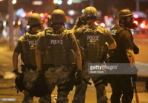 Police advance on demonstrators protesting the killing of teenager Michael Brown on August 17 2014 in Ferguson Missouri Police shot smoke and tear...