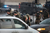 Police advance on protestors as they are forced from the business district into nearby neighborhoods on August 11 2014 in Ferguson Missouri Police...