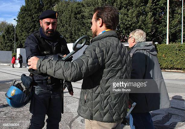 A police agent officer checks fans with a metal detector before the Serie A match between SS Lazio and US Citta di Palermo at Stadio Olimpico on...