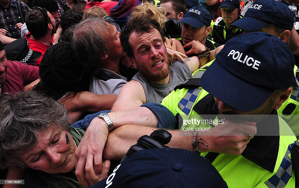 Police and climate protesters clash as police move in on a section of an antifracking demonstration outside the test drill site operated by British...