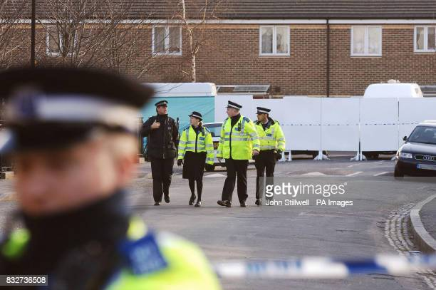 Police and community support officers walk along Diamond Street in Peckham south east London where a 15yearold boy was shot dead inside his home...