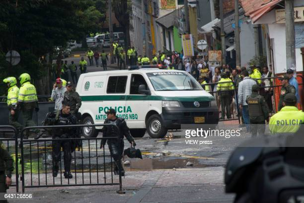 Police and crime scene investigators look for evidence after a bomb exploded in the Macarena neighborhood behind the La Santamaría bullfighting ring...