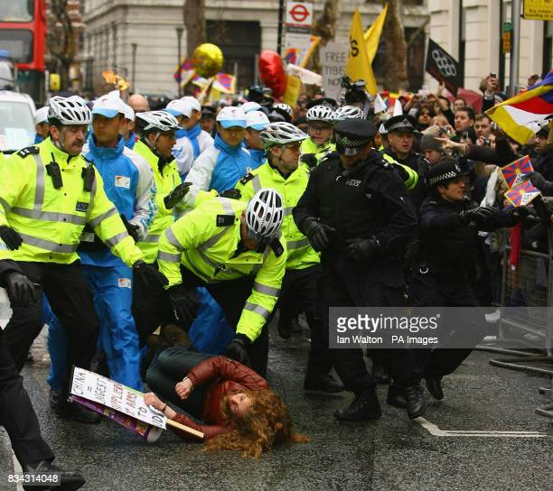 Police and demonstrators clash during the relay of the Olympic torch during its journey across London on its way to the lighting of the Olympic...