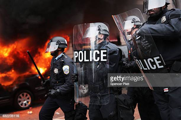 Police and demonstrators clash in downtown Washington after a limo was set on fire following the inauguration of President Donald Trump on January 20...