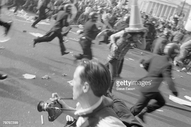 Police and demonstrators clash in Trafalgar Square during rioting which arose from a demonstration against the Poll Tax London 31st March 1990