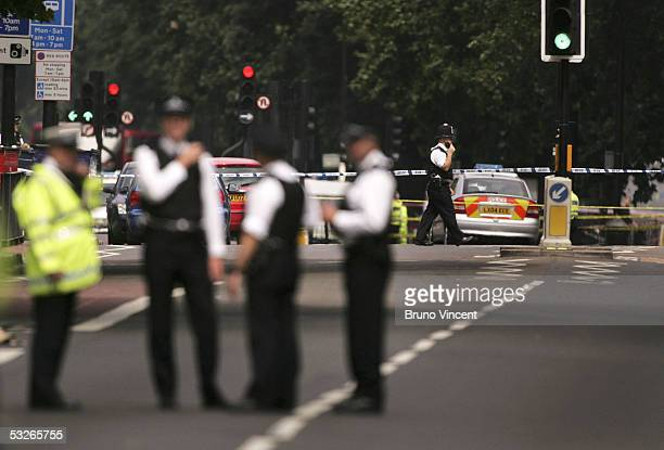 Police and Emergency services are seen outside the Oval Underground Station July 21 2005 in London Three London underground train stations have been...