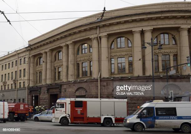 Police and emergency services personnel and vehicles are seen at the entrance to Technological Institute metro station in Saint Petersburg on April 3...