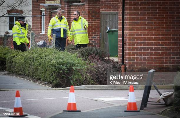 Police and engineers at the scene in Oatridge Gardens Hemel Hempstead after a sinkhole approximately 35ft wide and 20ft deep appeared under part of a...
