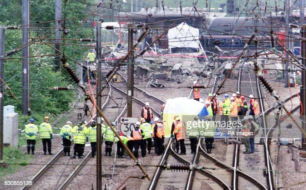 Police and engineers search the line where the train left the tracks the at Potter's Bar station Hertfordshire Railtrack said it was not aware that...