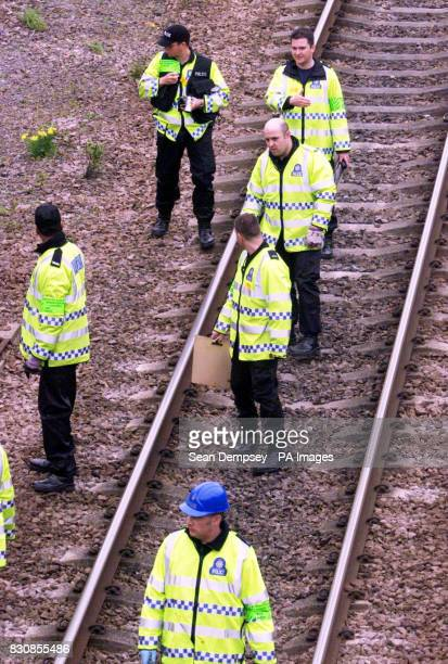 Police and engineers search the line where the train left the tracks at Potter's Bar station Hertfordshire Railtrack said it was not aware that there...