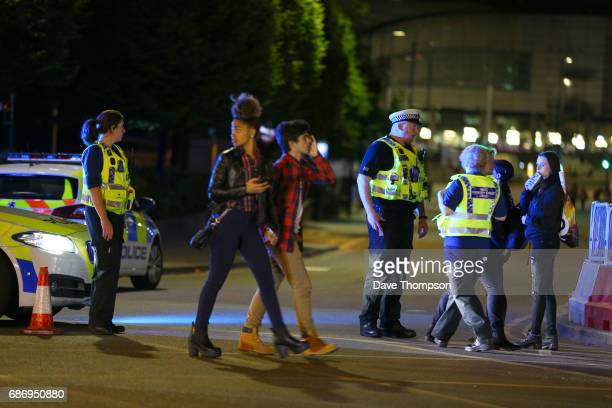 Police and fans close to the Manchester Arena on May 23 2017 in Manchester England An explosion occurred at Manchester Arena as concert goers were...