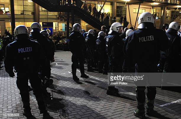 Police and fans of Hamburg are seen after the Bundesliga match between Hamburger SV and Bayer Leverkusen at Imtech Arena on December 11 2010 in...