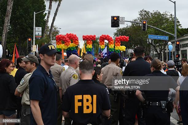 Police and FBI agents stand by to provide security for the 2016 Gay Pride Parade June 12 20116 in Los Angeles California Security for the tightened...