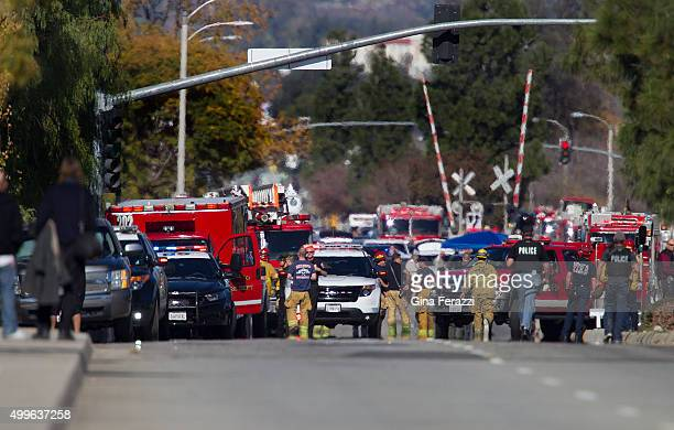 Police and fire personnel secure the scene where a mass shooting occurred at the Inland Regional Center on December 2 2105 in San Bernardino...