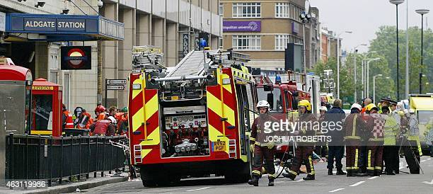 Police and fire personnel work outside London's Aldgate East tube station after an explosion occurred in the subway line 07 July 2005 Police said...