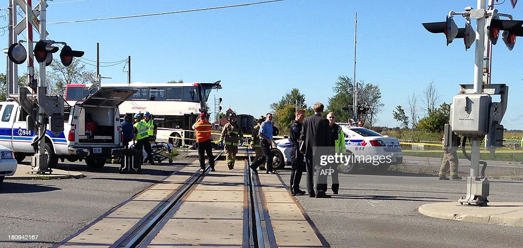 Police and firefighters respond to a double-decker bus that collided with a passenger train at a crossing in a suburb of Canada's capital on September 18, 2013, killing at least five people, an official said. Ottawa fire department spokesman Marc Messier told broadcaster CTV that at least five bus passengers died and up to six others were injured. The Via Rail company operating the affected train on the Ottawa to Toronto line -- on which traffic has been suspended -- reported no fatalities. The OC Transpo bus was on its way downtown during the morning rush hour when the accident happened, according to local media reports. The injured were being transported to area hospitals. Canadian broadcasters showed images of the front of the bus sheered off and the train derailed. Witnesses, meanwhile, recounted bus passengers being thrown from the bus. COMTE