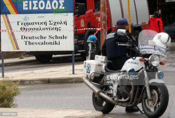 Police and firemen block the entrance to the German School in the northern Greek city of Thessaloniki on December 2 2009 during a hostage situation A...