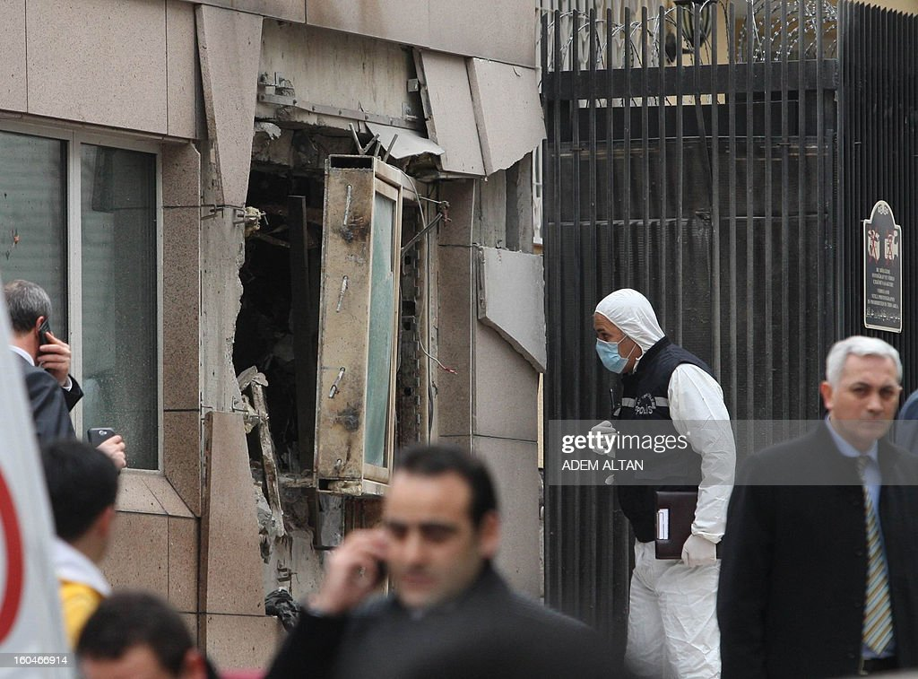 Police and forensic experts work on February 1, 2013 at the site of a blast outside the US Embassy in Ankara. Two security guards were killed in the blast outside the US embassy, local television reported, amid speculation it was a suicide attack. The force of the explosion damaged nearby buildings in the Cankaya neighborhood where many other state institutions and embassies are also located.
