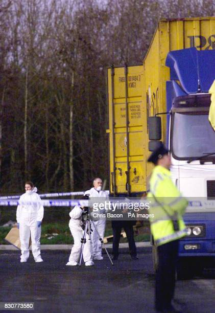 Police and forensic officers examine the lorry in which eight wouldbe refugees died and five others were left seriously ill after a plot to smuggle...