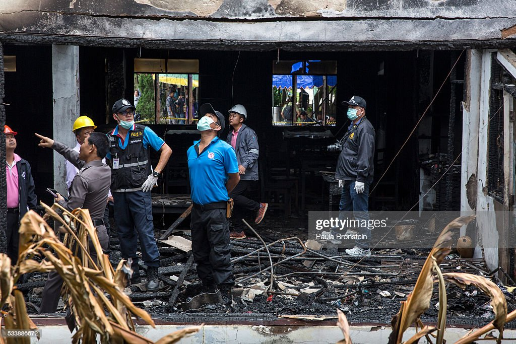 Police and forensic officials inspect the school dormitory where a fire broke out on Sunday night killing at least 17 girls on May 24, 2016 in Wiang Papao, Chiang Rai province, Thailand. The Pitakkiat Wittaya school was home to pupils from impoverished local hill tribes in the region, they were aged between 5 to 13. Based on reports, many of the 38 students were asleep when the fire swept through the elementary school in Chiang Rai Province and investigations are still being carried out to find the cause of the fire.