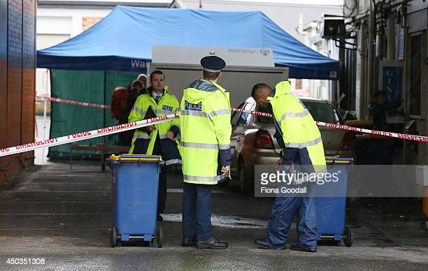 Police and forensic staff gather evidence in and around a Dairy in Great North Rd Henderson on June 10 2014 in Auckland New Zealand A homicide...