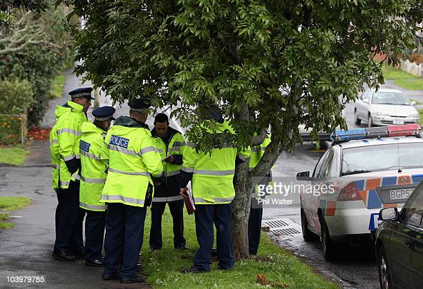 Police and forensic teams investigate a property in the Auckland suburb of Mount Eden where a body was found on September 11 2010 in Auckland New...