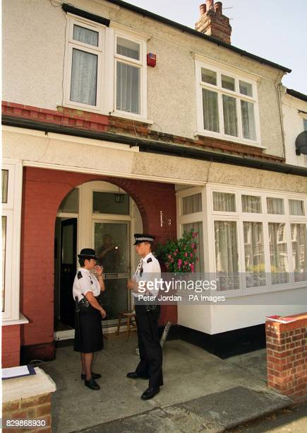 Police and forensics experts attend a house in Eastcombe Ave Charlton southeast London after the body of a young girl was found hidden in undergrowth...