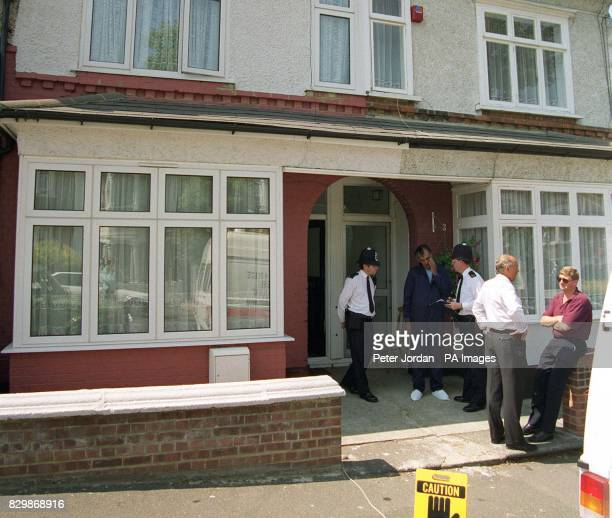 Police and forensics experts outside a house in Eastcombe Ave Charlton southeast London after the body of a young girl was found hidden in...
