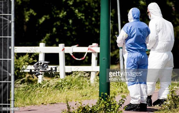 Police and forensics investigate with a drone near the spot where the body of 14 year old Savannah Dekker was found in Bunschoten on 3 June 2017 The...