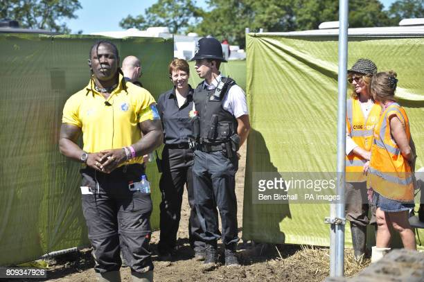 Police and Glastonbury festival security staff guard the entrance to the VIP winnebago area of the hospitality area where a body has been discovered...
