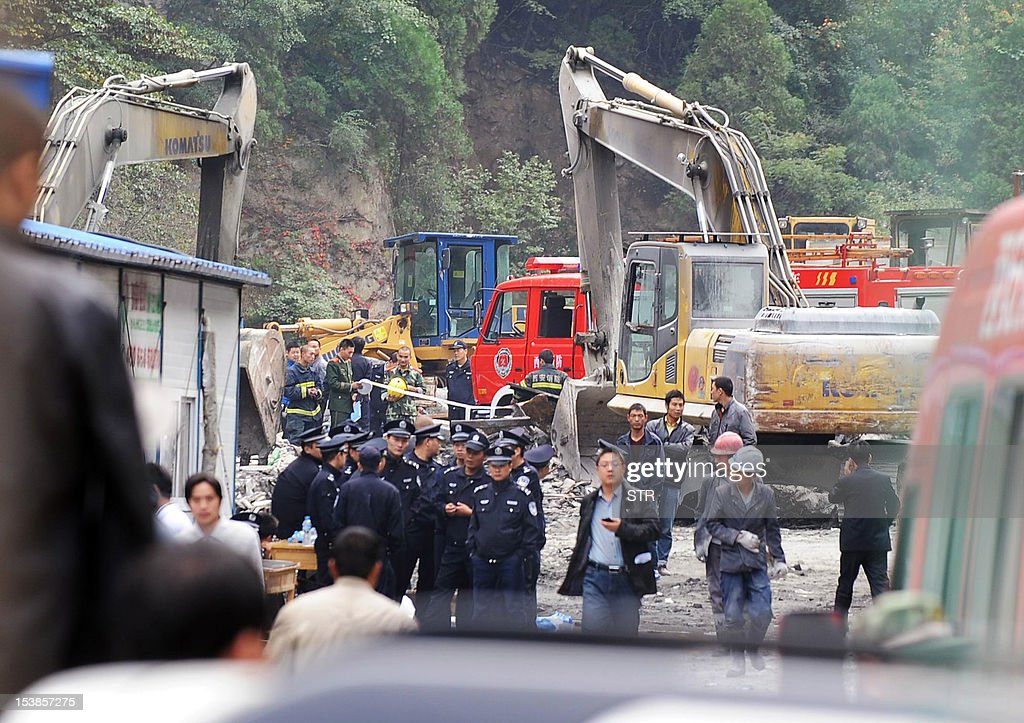 Police and investigators cordon off the site where 12 Chinese construction workers were killed and another 24 others injured in a fire at their dormitory at a water-diversion project in Zhouzhi county of Xian in the northwestern province of Shaanxi on October 10, 2012. The blaze broke out at a water-diversion project in Zhouzhi county in the northwestern province of Shaanxi, state media quoted a statement from local authorities as saying. CHINA