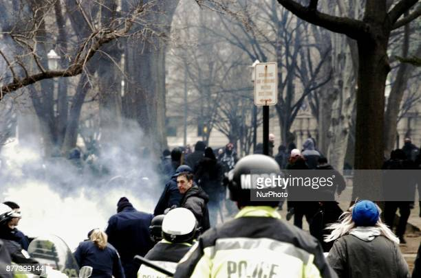 Police and Journalist run toward Franklin Square after protesters set off smoke bombs in the park and start running toward streets on the far side of...