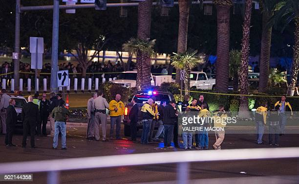 Police and local officials investigate a part of the Las Vegas Strip after a car ran into a group of pedestrians between Planet Hollywood where the...
