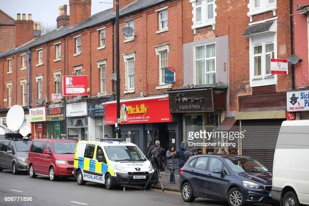 Police and media work outside the flat above Shiraz Restaurant in Hagley Road Birmingham which was raided by antiterror police in connection with the...