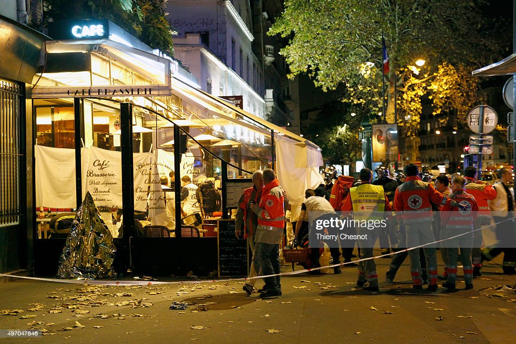 Police and medics gather after an attack near the Boulevard des FillesduCalvaire November 13 2015 in Paris France Gunfire and explosions in multiple...