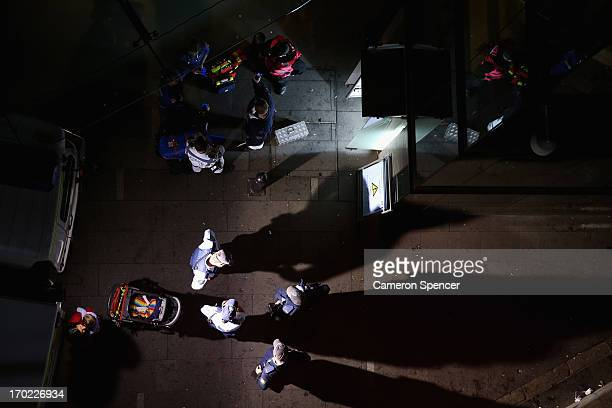 Police and medics wait to attend people stuck in a broken down elevator during Vivid Festival at Circular Quay on June 9 2013 in Sydney Australia...